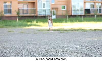 little girl runs bouncing around - little girl running...