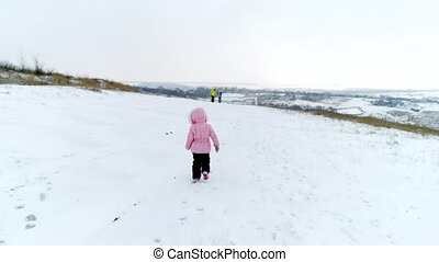 Little girl runs to her mother