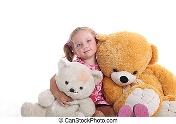 Little girl sat with cuddly toys
