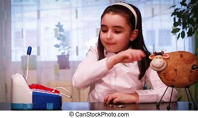 Little girl saving for school