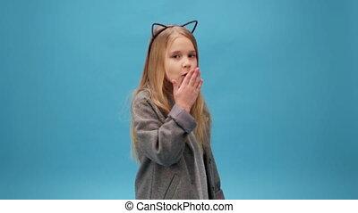 little girl sends an air kiss