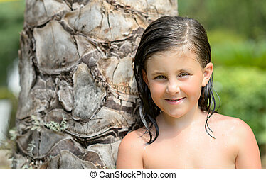 little girl setting smile at the camera