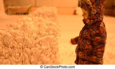 Little Girl Shake off Snow from Bush, Night Light
