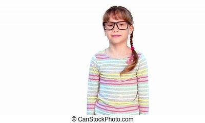 Little girl shaking her forefinger at camera
