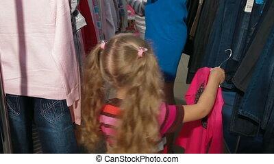 Little Girl Shopping Clothes