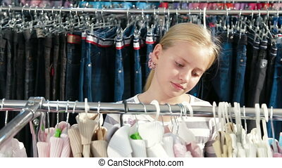 Little Girl Shopping For Clothes