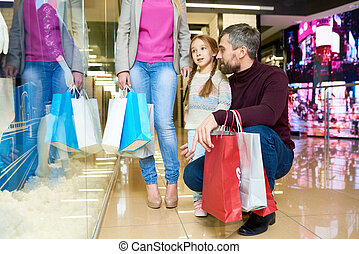 Little Girl Shopping with Parents