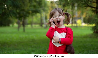 Little girl shouting into the phone