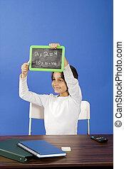 little girl showing chalkboard