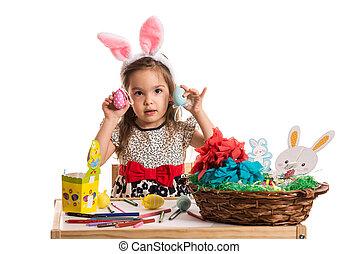 Little girl showing Easter eggs