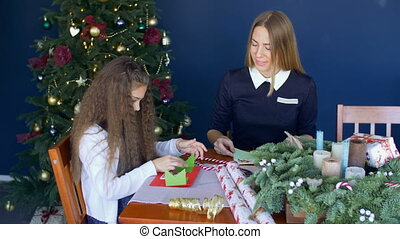 Little girl showing handmade greeting card to mom - Positive...