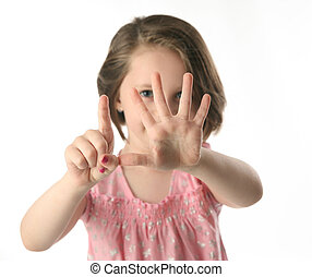 Little girl showing her age with fingers - Portrait of a...