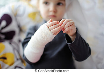 Little girl showing her bandaged hand - Little baby girl...