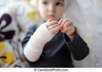 Little girl showing her bandaged hand - Little baby girl...