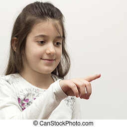 little girl showing with the index finger
