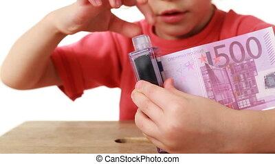 little girl shows focus transforming euros into dollars