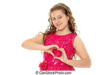 Little girl shows heart with her hands.