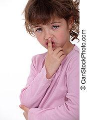Little girl shushing