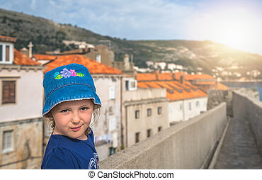 Little girl sightseeing Old Town in Dubrovnik