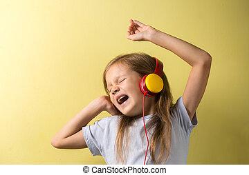 Little girl singing in headphones