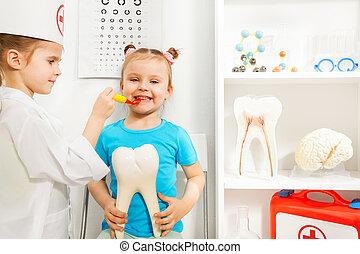 Little girl sitting at dentist's examination