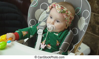 little girl sitting at the table - little girl sits at the...