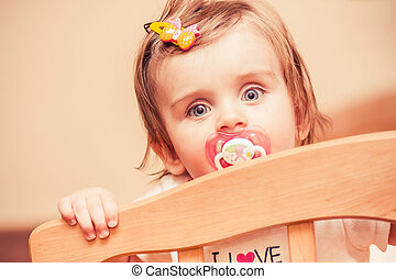 little girl sitting in a crib with. rendering