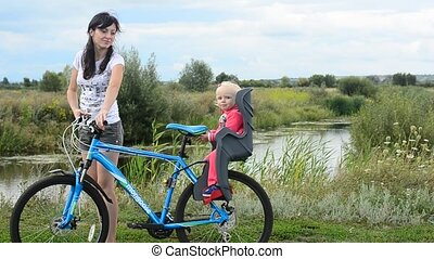 Little girl sitting in bicycle chai