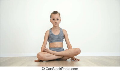 Little Girl Sitting In Lotus Position