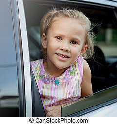 little girl sitting in the car