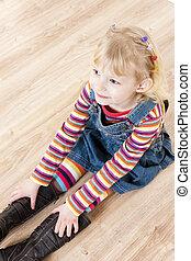 little girl sitting on floor