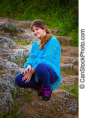 girl sitting on stone