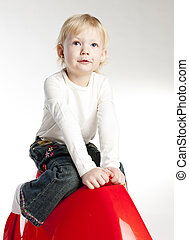 little girl sitting on swing