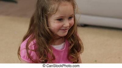 Little girl sitting on the floor sm