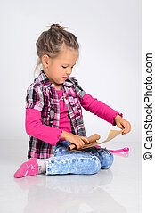 Little girl sitting on the floor