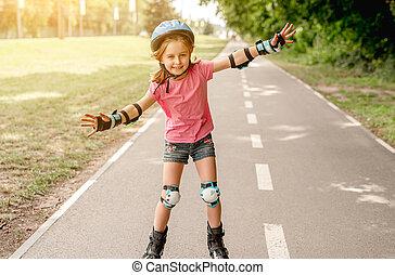 Little girl skating on roller blades