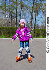 Little girl skating on roller skates