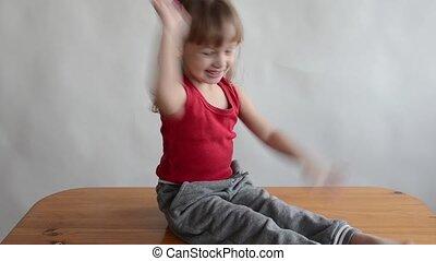 Little girl slaps her knees