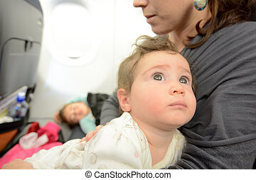 little girl sleeping in a plane