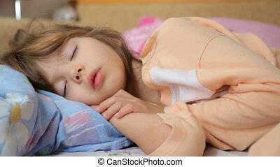 Little girl sleeping in morning light