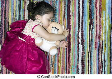 Little girl sleeping on a colorful