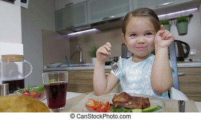 Little girl smile and having family dinner