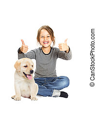 Little girl smiling and and labrador