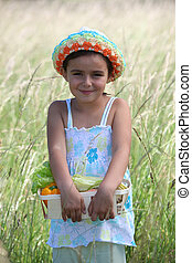 Little girl smiling in a field