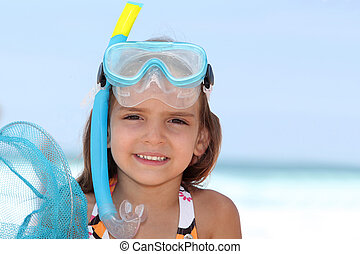 Little girl snorkeling.