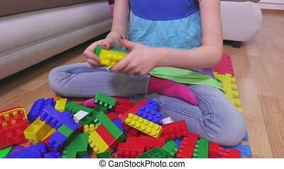 Little girl sorting toy bricks