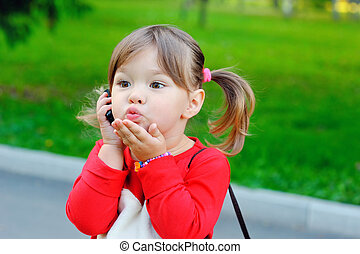 Little girl speak on the phone
