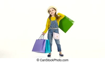 Little girl spinning around itself with colorful packages. White background