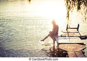 little girl splashing at the lake