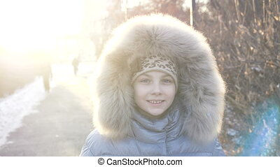 Little girl standing and smiling on the cam in the winter...